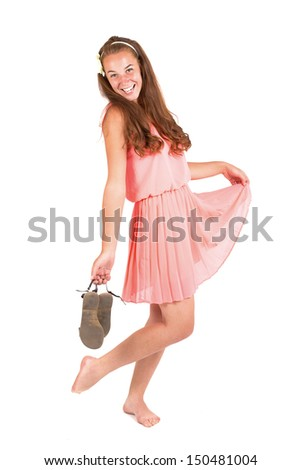 Beautiful young girl in sandals on a white background - stock photo