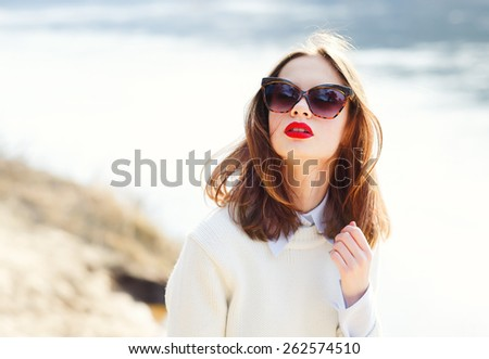 beautiful young girl in sunglasses on the beach - stock photo