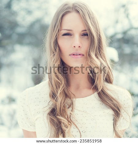 beautiful young girl in the park in winter - stock photo
