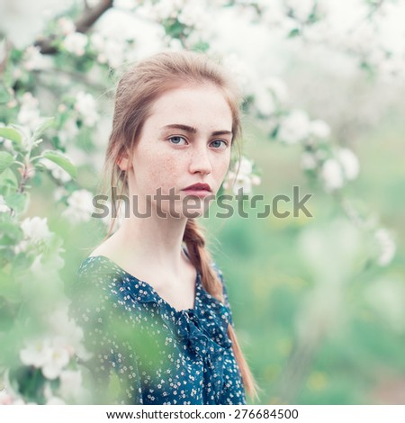beautiful young girl in the spring garden - stock photo