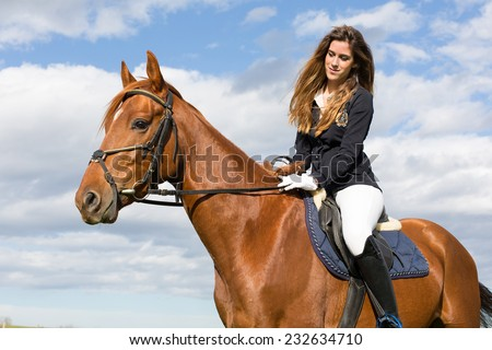Beautiful young girl in uniform competition ride her brown horse : outdoors portrait on sunny day - stock photo