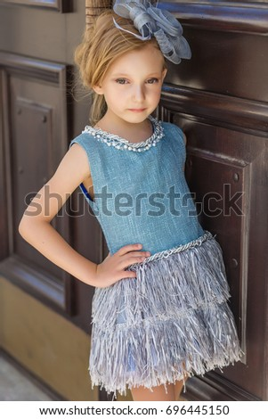 Beautiful young girl in vintage dress posing outdoors