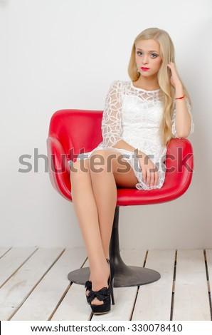 Young Beautiful Blonde Girl White Short Stock Photo