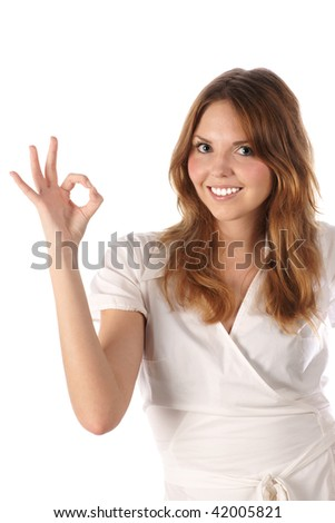 Beautiful young girl indicating ok sign - stock photo
