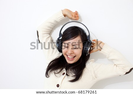 beautiful young girl listening to music - stock photo