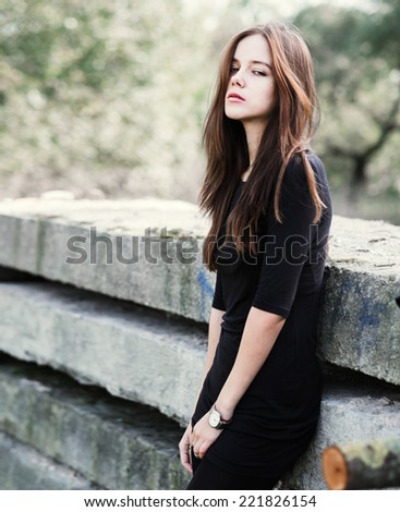 beautiful young girl model in a park in warm autumn day - stock photo