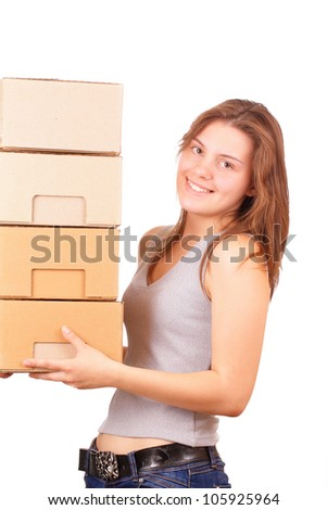 Beautiful young girl moving into a new house - stock photo