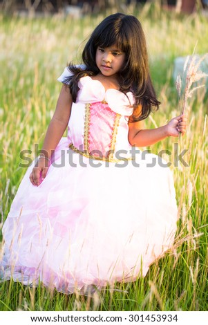 beautiful young girl on field of grass flower - stock photo