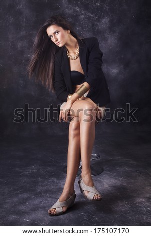 Beautiful young girl on gray background posing