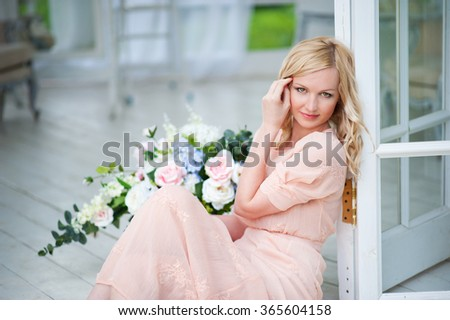 Beautiful young girl on the summer terrace