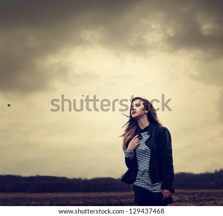 beautiful young girl outdoors - stock photo