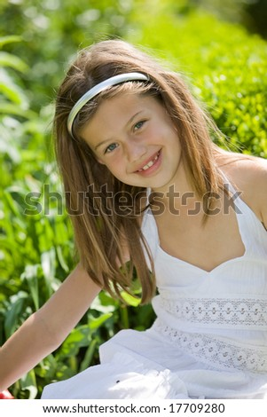 Beautiful young girl outdoors on a summer day - stock photo
