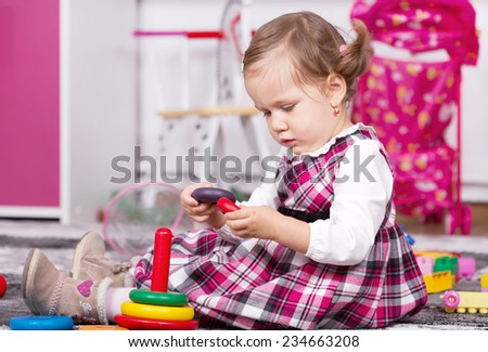 Beautiful young girl playing inside  - stock photo