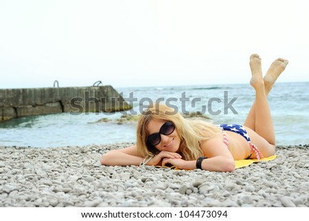 beautiful young girl posing at the summer beach