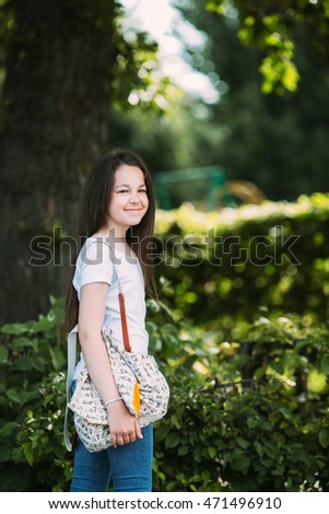 beautiful young girl posing for the camera in the park