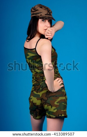 Beautiful young girl posing in street clothes on blue background.Isolated studio portrait