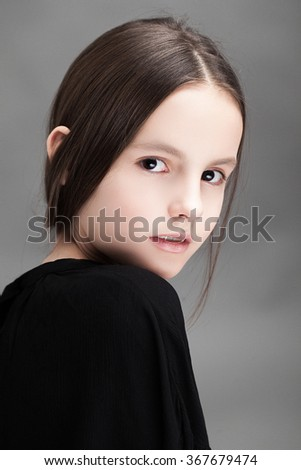 Beautiful young girl  posing in the studio - stock photo