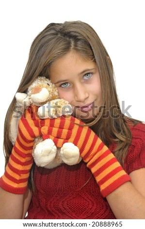 Beautiful young girl posing with gloves and bunny against a white background