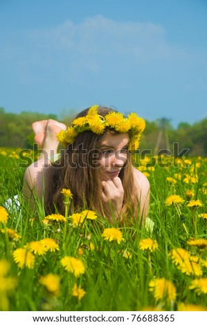 beautiful young girl resting in a meadow