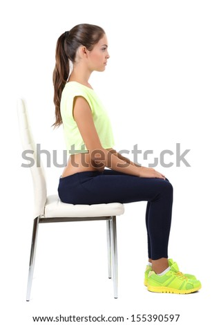Beautiful young girl resting on chair isolated on white