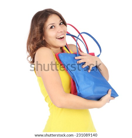 beautiful young girl shopping closeup - stock photo