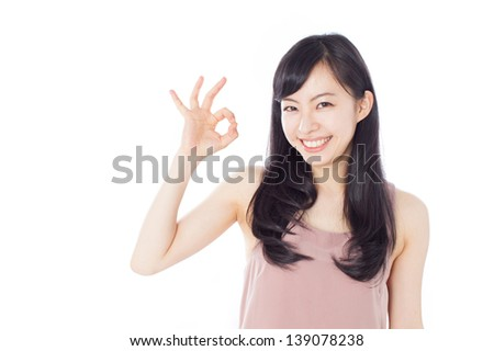beautiful young girl showing thumbs up gesture, isolated on white background - stock photo
