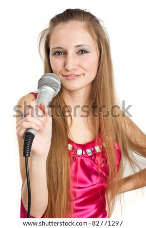 beautiful young girl singing into a microphone, isolated over white