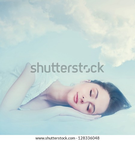 beautiful young girl sleeping and dreaming in the clouds - stock photo