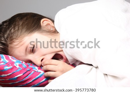 Beautiful young girl sleeping in bed