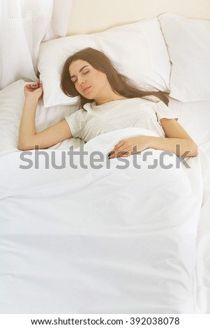 Beautiful young girl sleeping in the bedroom.
