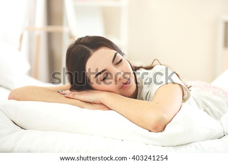 Beautiful young girl sleeping in the bedroom. - stock photo