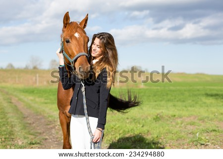 Beautiful young girl smile at her horse dressing uniform competition: outdoors portrait on sunny day