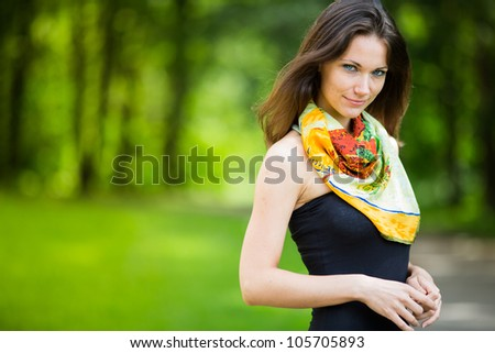 Beautiful young girl smiling in a park - Outdoor with summer background