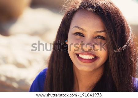 Beautiful young girl smiling in nature