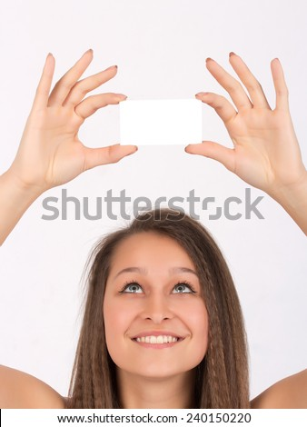 Beautiful Young Girl Staring At Blank White Business Card - stock photo