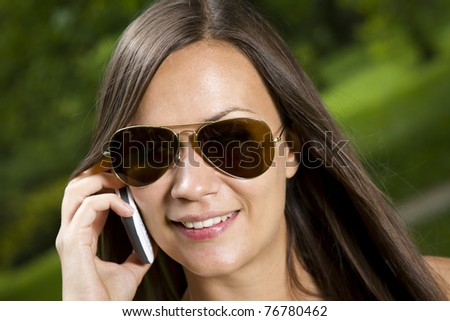 Beautiful young girl talking on the phone