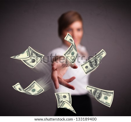 Beautiful young girl throwing money - stock photo