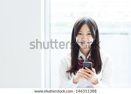 beautiful young girl using smart phone  - stock photo