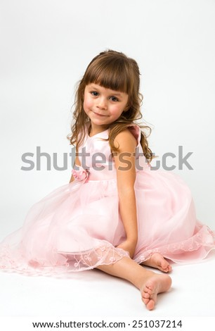 beautiful young girl wearing a fancy pink dress