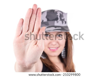 Beautiful young girl wearing a military cap gesturing stop with hand isolated on white selective focus - stock photo