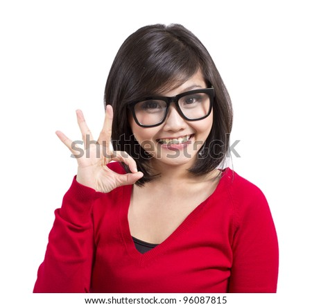 beautiful young girl wearing nerd glasses making okay sign