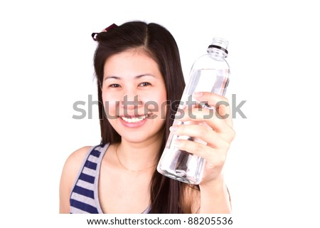 Beautiful young girl  with a bottle of mineral water on white back ground