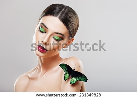 Beautiful young girl with a butterfly - stock photo