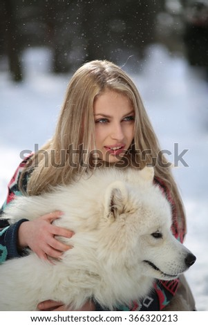 Beautiful young girl with a dog Huskies