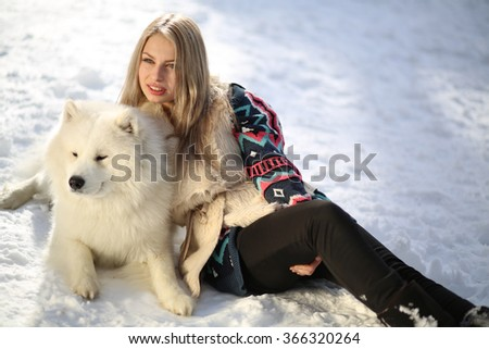 Beautiful young girl with a dog Huskies - stock photo