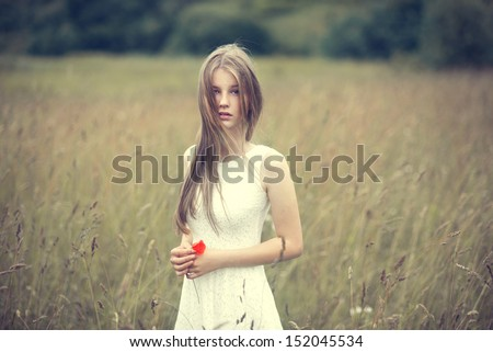 beautiful young girl with a flower - stock photo
