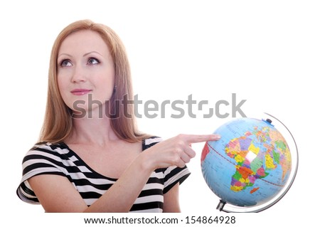 Beautiful young girl with a globe on a white background