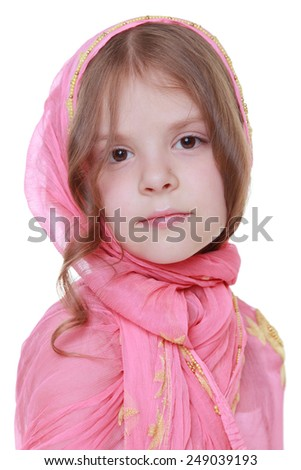 Beautiful young girl with a sweet smile in the eastern scarf isolated on white on Beauty and Fashion