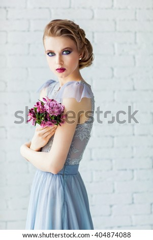 Beautiful young  girl with a wedding bouquet