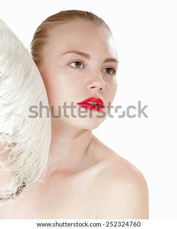 Beautiful young girl with a white feather. Spy beauty skin treatment woman. Healthy lifestyle concept.  - stock photo